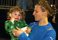 Kristine Lilly#13 and daughter after the home opener for the Washington Freedom in a WPS match against the Boston Breakers on April 10 2010, at the Maryland Soccerplex, in Boyds, Maryland. Breakers won 2-1.