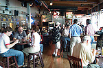 Alaska, Juneau: Dining in Juneau on the wharf and at the Hangar On The Wharf in front of the float plane dock. .Photo #: alaska10130 .Photo copyright Lee Foster, 510/549-2202, lee@fostertravel.com, www.fostertravel.com.