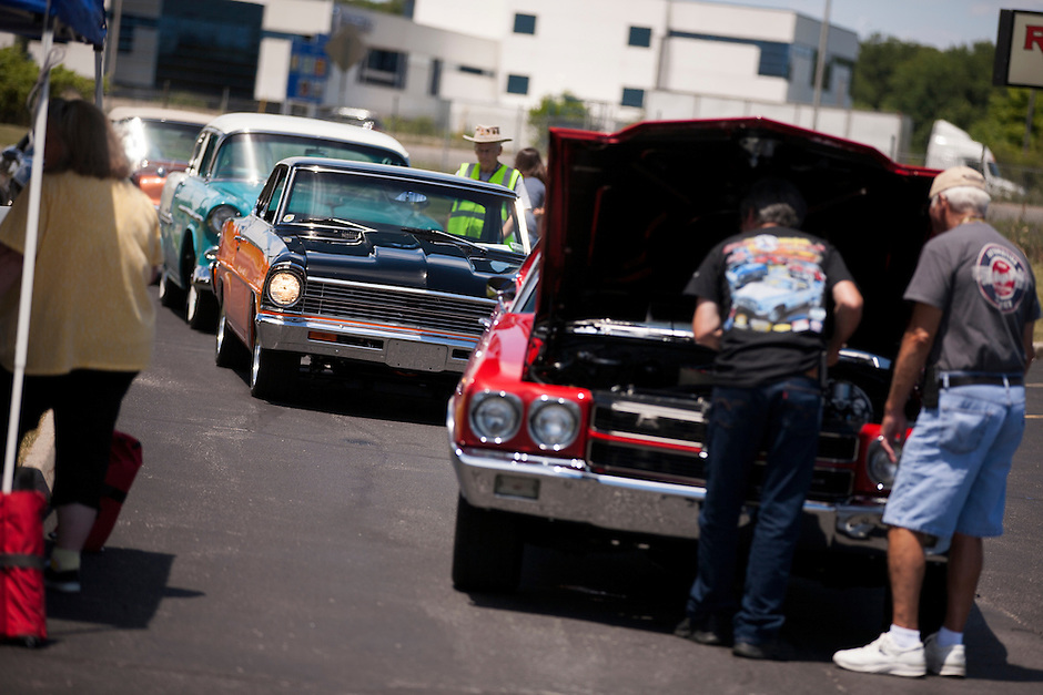 Drivers line up their cars for tech check and classification during 4th State Representative Chevy Show on Thursday, June 30, 2016, in Fort Wayne, Indiana. (Photo by James Brosher)