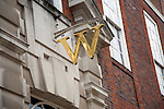 Golden W sign for Waterstones bookshop, Colchester, Essex