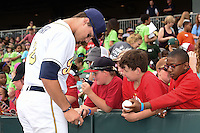 Montgomery Biscuits third baseman Richie Shaffer (12) signs autographs before a game against the Mississippi Braves on April 22, 2014 at Riverwalk Stadium in Montgomery, Alabama.  Mississippi defeated Montgomery 6-2.  (Mike Janes/Four Seam Images)