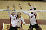 Renee Bordelon (#16), Rachel Todorovich (#7) and Brittany Tillman (#21) are shown during a Washington State volleyball match at Bohler Gym in Pullman, Washington, on September 11, 2009.