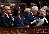 Former President Barack Obama, Michelle Obama, former President Bill Clinton and former Secretary of State Hillary Clinton listen during the State Funeral for former President George H.W. Bush at the National Cathedral, Wednesday, Dec. 5, 2018, in Washington.<br /> Credit: Alex Brandon / Pool via CNP