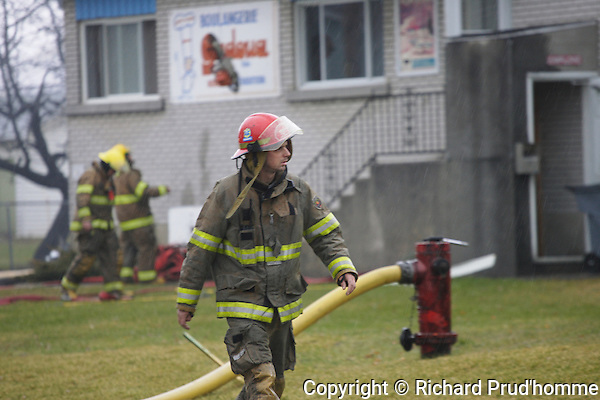 A fireman on the site of a fire in St-Thomas-de-Joliette, Quebec