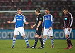 Hearts v St Johnstone.....05.03.13      SPL.Frazer Wright and Rowan Vine plead with ref John Beaton.Picture by Graeme Hart..Copyright Perthshire Picture Agency.Tel: 01738 623350  Mobile: 07990 594431