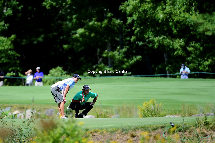 Friday, September 2, 2016:  Patrick Reed and his caddy Kessler Karain read a putt on the on the second green during the first round of the Deutsche Bank Championship tournament held at the Tournament Players Club, in Norton, Massachusetts.  Eric Canha/Cal Sport Media