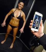 DOYLESTOWN, PA - FEBRUARY 13: Nicole Jenet (L) of Warrington, Pennsylvania is photographed by owner Kristen Valentin, after receiving a spray tan at Bella Sorrel February 13, 2015 in Doylestown, Pennsylvania.  They operate a salon with three airbrush tanning rooms and are looking to franchise their concept across the country.  (Photo by William Thomas Cain/Cain Images)