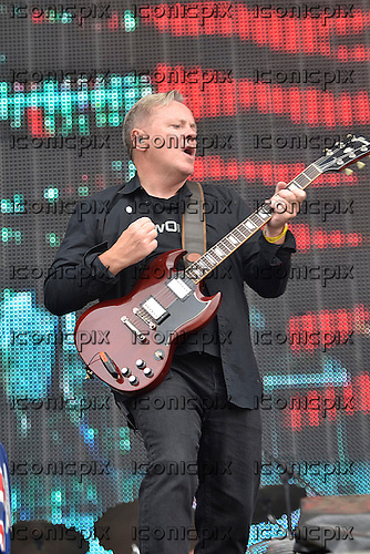 NEW ORDER - vocalist and guitarist BERNARD SUMNER - performing live at BT London Live 2012 Olympic Concert held in Hyde Park London UK - 12 Aug 2012.  Photo credit: George Chin/IconicPix
