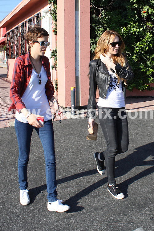 **ALL ROUND PICTURES FROM SOLARPIX.COM**.**WORLDWIDE SYNDICATION RIGHTS**.**NO PUBLICATION IN AUSTRALIA, NEW ZEALAND, DENMARK, GERMANY OR USA**.Lindsay Lohan and Samantha Ronson start their day with lunch at Genghis Cohen Restaurant in Hollywood followed by some cigarettes. Hollywood, California, USA. 20th September 2008..JOB REF: 7424 LAP(HDM)       DATE: 20_09_2008.**MUST CREDIT SOLARPIX.COM OR DOUBLE FEE WILL BE CHARGED* *UNDER NO CIRCUMSTANCES IS THIS IMAGE TO BE REPRODUCED FOR ANY ONLINE EDITION WITHOUT PRIOR PERMISSION*