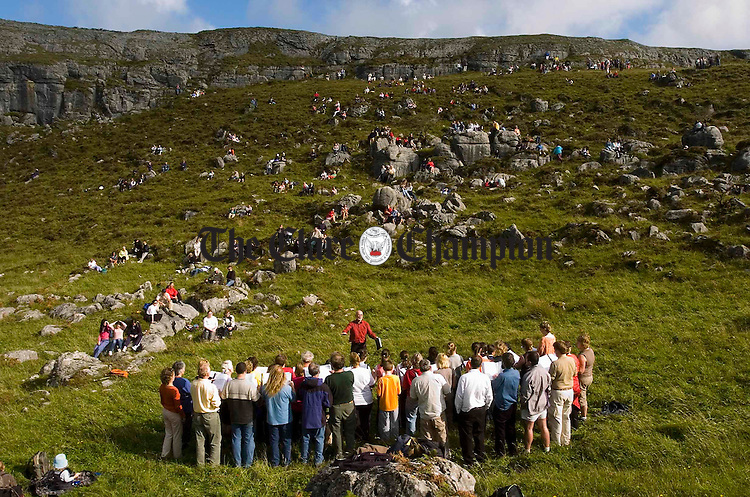 "the Lismorahaun Singers performance of ""The Voice of the Mountain"" as part of the Burren Ramble in aid of the RNLI. Photograph by John Kelly."
