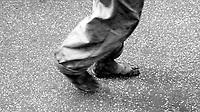 Roma .Senza fissa dimora, vaga per la città a piedi nudi.The homeless, wanders through the city barefoot