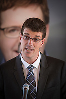 PQ candidate for the riding of Chauveau Sebastien Couture gestures as he talk during the presentation of parti Quebecois candidates for the upcoming byelection Tuesday May 5, 2015.