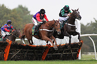 Race winner Close Touch ridden by Barry Geraghty jumps alongside Chain Of Events ridden by Jack Doyle (R) in the Michael Scotney Memorial Novices Hurdle