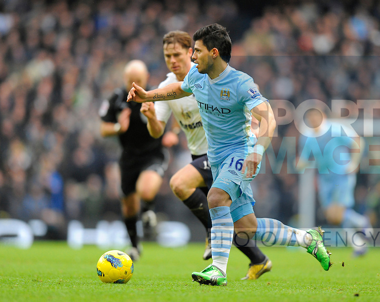 Sergio Aguero of Manchester City and Scott Parker of Tottenham.Barclays Premier League.Manchester City v Tottenham at the Eithad Stadium, Manchester 22nd January, 2012..Sportimage +44 7980659747.picturedesk@sportimage.co.uk.http://www.sportimage.co.uk/.Editorial use only. Maximum 45 images during a match. No video emulation or promotion as 'live'. No use in games, competitions, merchandise, betting or single club/player services. No use with unofficial audio, video, data, fixtures or club/league logos.