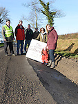 Local residents Willie Cole, Olan Lynch, Pauline Dunne, Faere and Ciara Lynch, Gerard Weldon and Pat Dunne pictured in one of the many potholes at Strinagh, Broomfield. Collon. Photo:Colin Bell/pressphotos.ie