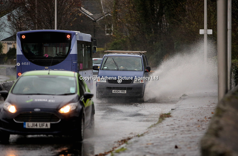 WEATHER WALES<br />Pictured: A van drives through a flooded road by Mumbles promenade in Swansea, Wales, UK. Monday 21 November 2016<br />Re: Flood warnings have been issued and Severe rain will be affecting most parts of Wales, UK