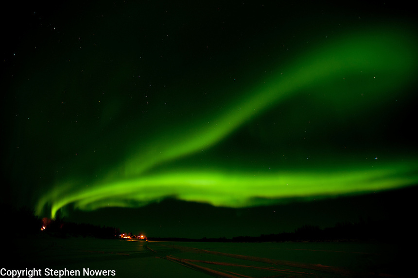 The northern lights blaze over the Kuskokwim River and the town of McGrath during the 2011 Iditarod.