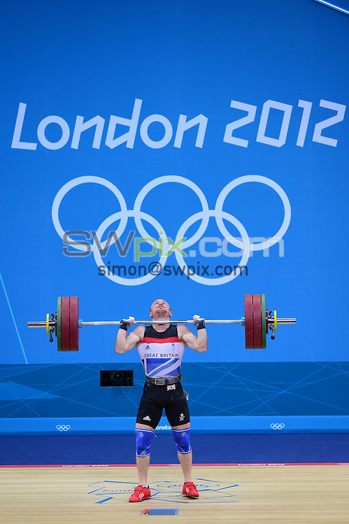 PICTURE BY ALEX BROADWAY /SWPIX.COM - Olympics - Day Four - Weightlifting - Excel Centre, London, England - 31/07/12 - Gareth Evans of Great Britain competes in the Men's 69kg Weightlifting.