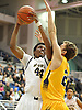 Justin Caldwell #44 of Baldwin, left, battles against Bryce Paladino #21 of Massapequa during the Nassau County varsity boys basketball Class AA semifinals at Hofstra University on Tuesday, Feb. 23, 2016. Top-seeded Baldwin had a 23-21 lead at halftime.