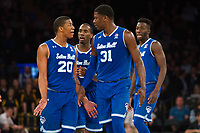 NEW YORK, NY - Thursday March 9, 2017: Angel Delgado (#31) of Seton Hall calms down his teammate Desi Rodriguez (#20) of Seton Hall after a brief altercation with Marquette as the two schools square off in the Quarterfinals of the Big East Tournament at Madison Square Garden.