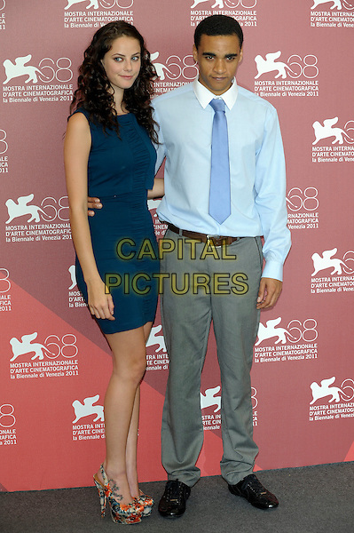 Kaya Scodelario & James Howson.The 'Wuthering Heights' Photocall during the 68th Venice International Film Festival at Palazzo del Casino, Venice, Italy..September 6th, 2011.full length blue teal dress sleeveless shirt tie grey gray trousers tattoo platform slingback shoes orange floral print.CAP/PL.©Phil Loftus/Capital Pictures.
