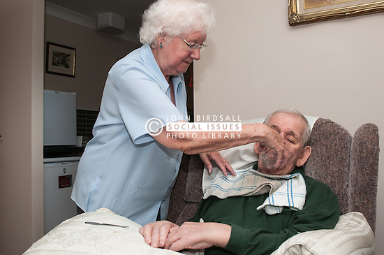 A retired couple in supported housing caring for each other