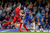Willian of Chelsea bursts through the Huddersfield Town defence during Chelsea vs Huddersfield Town, Premier League Football at Stamford Bridge on 9th May 2018
