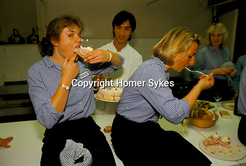 Part time catering staff at Fishmongers Hall 1992 eat after the banquet has been cleared away.