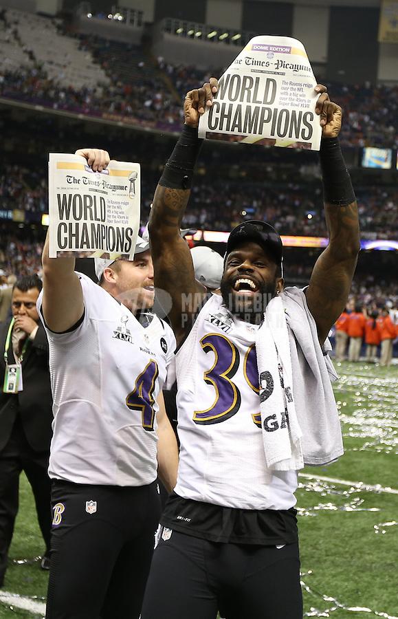 Feb 3, 2013; New Orleans, LA, USA; Baltimore Ravens cornerback Chris Johnson (right) and punter Sam Koch celebrate after defeating the San Francisco 49ers in Super Bowl XLVII at the Mercedes-Benz Superdome. Mandatory Credit: Mark J. Rebilas-