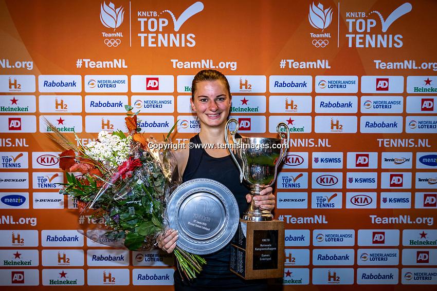 Alphen aan den Rijn, Netherlands, December 22, 2019, TV Nieuwe Sloot,  NK Tennis, Woman's single winner Querine Lemoine with the trophy<br /> Photo: www.tennisimages.com/Henk Koster