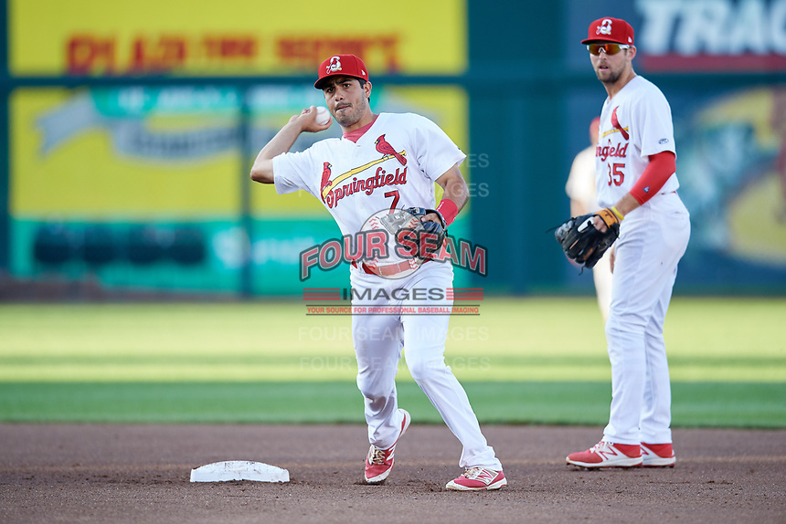 Springfield Cardinals shortstop Alex Mejia (7) throws to first base in front of second baseman Dickie Joe Thon (35) during a game against the Corpus Christi Hooks on May 30, 2017 at Hammons Field in Springfield, Missouri.  Springfield defeated Corpus Christi 4-3.  (Mike Janes/Four Seam Images)