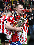Sheffield United's Caolan Lavery celebrates with the trophy during the League One match at Bramall Lane, Sheffield. Picture date: April 30th, 2017. Pic David Klein/Sportimage
