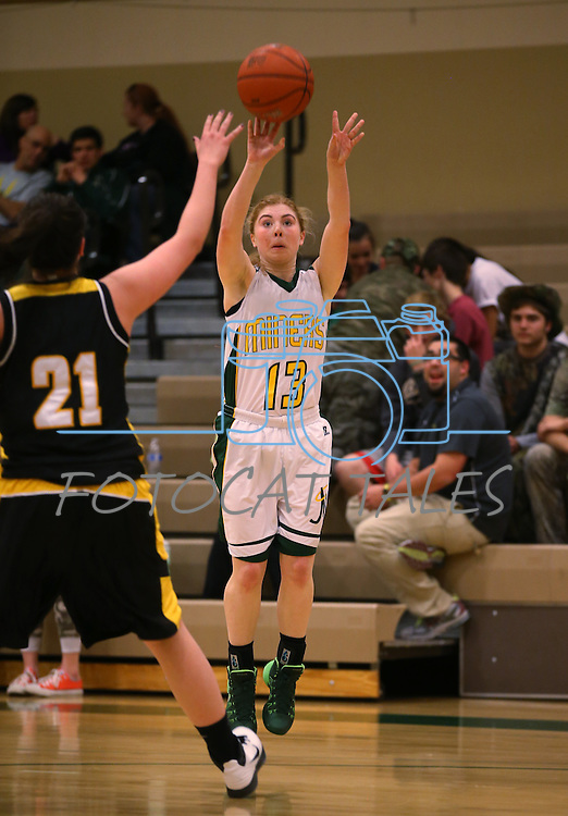 Manogue's Tawni Henderson shoots against Galena at Manogue High School in Reno, Nev., on Tuesday, Feb. 11, 2014. Manogue won 51-29.<br /> Photo by Cathleen Allison