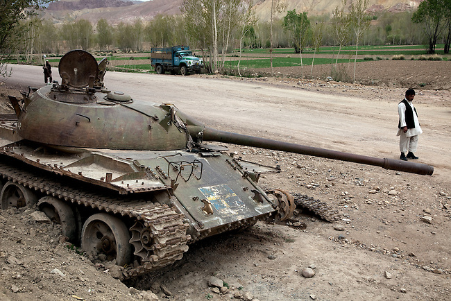 08 May 2012, Bamiyan, Afghanistan :  An antique Russian tank stands wrecked on the outskirts of Bamiyan City - a testament to the countless wars and battles fought over this ancient city . Picture by Graham Crouch/World Bank