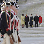 Washington, DC - January 20, 2009 -- United States President Barack Obama, his wife Michelle (L), Vice President Joseph Biden (2-R) and his wife Jill (R) are escorted by Major General Richard Rowe as they review the Commander-In-Chief's Guard from the steps of the U.S Capitol Building after Obama was sworn in as the 44th President of the United States during the 56th Presidential Inauguration ceremony in Washington, D.C., USA 20 January 2009..Credit: Tannen Maury - Pool via CNP