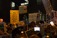 Hundreds of students and other activists hold candles and signs (some reading Abexit) as they  protest outside the Japanese Prime Minister's office calling on the Japanese Prime Minister, Shinzo Abe and Finance Minister, Taro Aso to resign over a suspected cover-up of the Moritomo Gakuen school  land sale scandal and falsified documents. Kasumigaseki, Tokyo, Japan Friday, March 23rd 2018