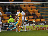 Jamie Murphy (centre) scores in the Motherwell v Aberdeen, Clydesdale Bank Scottish Premier League match at Fir Park, Motherwell on 26.12.12.