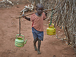 A girl carries water in the Kaya Refugee Camp in Maban County, South Sudan. Kaya is one of four camps in Maban County that together shelter more than 130,000 refugees from the Blue Nile region of Sudan.