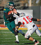 SPEARFISH, SD - NOVEMBER 23, 2013:  Ward Anderson #17 of Black Hills State tries to dodge Western State Colorado University tackler Mike Lopez 15 during their game Saturday at Lyle Hare Stadium in Spearfish, S.D. Black Hills State won 50-48 in triple overtime.  (Photo by Dick Carlson/Inertia)