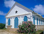Anguilla, BWI<br /> White walls of St Andrews Anglican Church with flowering oleander in Anguilla's village of Island Harbor