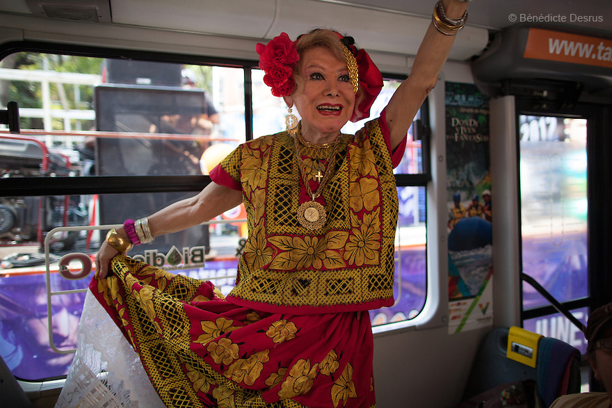 """June 2, 2012 - Mexico, Mexico City - Samantha makes up and wears a traditionalTehuanadress to celebratethe Gay PrideDayinMexico City.Samantha Flores is an 80-year-old transgender woman from Veracruz, Mexico. She is a prominent social activist for LGBTQI rights and is the founder of the non-profit organization """"Laetus Vitae"""", a day shelter for elderly gay people in Mexico City. Senior citizens in general are many times prone to neglect and abandonment by their families, leaving them all but invisible. Their plight can be even worse if they are homosexual. Photo credit: Bénédicte Desrus"""