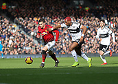 9th February 2019, Craven Cottage, London, England; EPL Premier League football, Fulham versus Manchester United; Ryan Babel of Fulham challenges Diogo Dalot of Manchester United