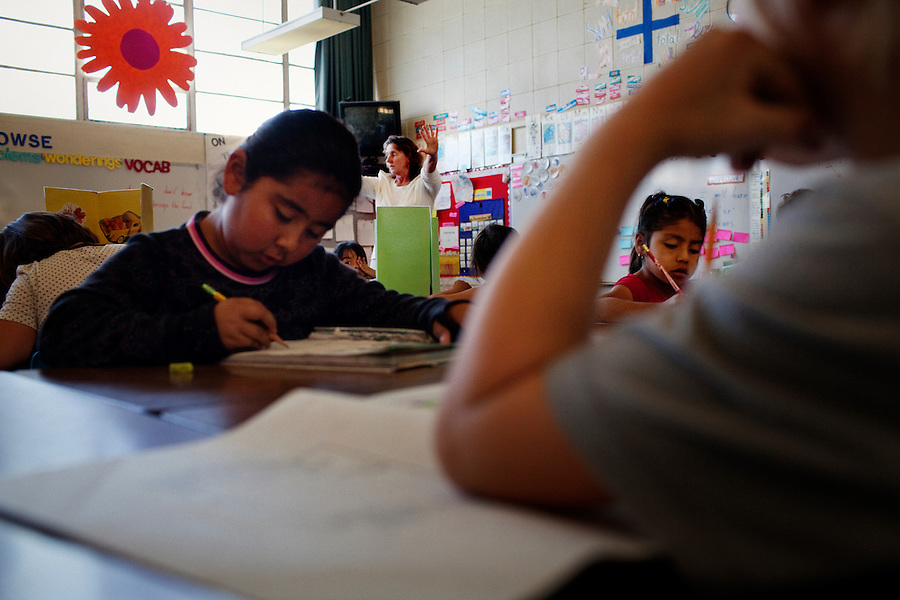 "Oceano, California, November 1, 2011 - Teacher Marcia Bess works with her 2nd grade class at Oceano Elementary School. As a part of an effort to help bridge some of the contrasts in school performance here, the 10,800-student school district of Lucia Mar recently became the first in California to adopt, in four of its schools, the Teacher Advancement Program (TAP) school-reform initiative. The complex model couples professional development, teacher observations keyed to a set of teaching standards and  leadership opportunities for teachers. Bess says she was origianlly leary of the TAP program, but now says she loves it. Adding, ""We were nervous with the talk about merit pay, but now I really don't care. I am having fun teaching again. There are so many fresh ideas that are getting students motivated. I just love it."""