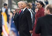 United States President Donald Trump (L), former President Barack Obama (C) and former First Lady Michelle Obama walk together following the inauguration, on Capitol Hill in Washington, D.C. on January 20, 2017. President-Elect Donald Trump was sworn-in as the 45th President.   <br /> Credit: Kevin Dietsch / Pool via CNP