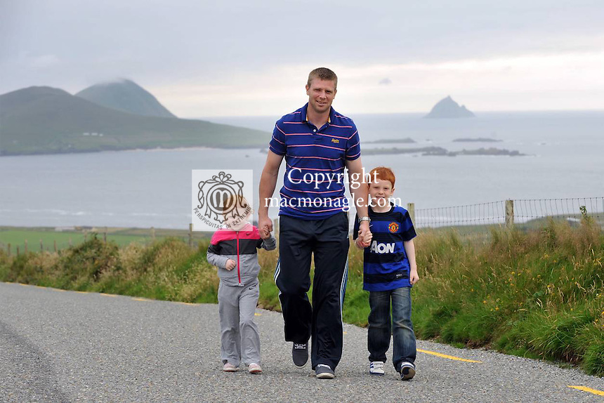 GAA History to be made: Kerry footballer Tomas O'Se with his son Micheal(6)  and daughter Ailidh (3) pictured overlooking the Blasket Islands outside Dingle in County Kerry this week ahead of becoming the most 'capped' GAA footballer in the country surpassing his brother Darragh with 82 championships appearances when he lines out against Clare on Saturday. Tomas first played in the Munster semi-final against Cork in Killarney in July 1998. He has worn the no5 jersey at half back on most occassions, a position made famous also by his uncle Paidi O'Se. He holds 5 All-Ireland medals and 8 Munster championships..Picture by Don MacMonagle
