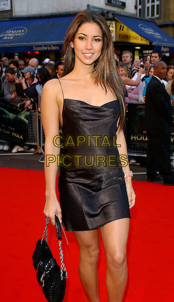 "LEILANI.""House of Wax"" UK Film Premiere, Vue Cinema, Leicester Square, London.May 24th, 2005.half length little black dress silk satin black purse.www.capitalpictures.com.sales@capitalpictures.com.© Capital Pictures."