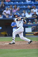 Asheville Tourists designated hitter Max George (3) swings at a bunt during a game against the West Virginia Power at McCormick Field on May 10, 2017 in Asheville, North Carolina. The Tourists defeated the Power 4-3. (Tony Farlow/Four Seam Images)