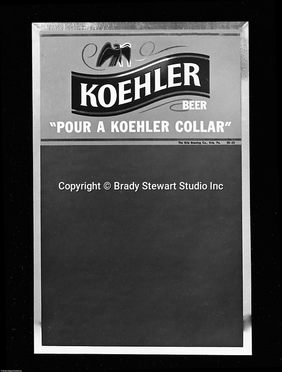 Erie Brewing Company 1961:  Koehler Beer premium advertising signs for Bars and Restaurants.  This sign includes the three characters that relate to Koehler's three beer products; Koehler Lager, Koehler Pilsner & Koehler Select.  Preiums were developed for Koehler's Pittsburgh Advertising Agency; Lando Advertising Inc and photographed by Brady Stewart Studio.  Lando owned and was located in the same building as Brady Stewart Studio - 725 Liberty Avenue in downtown Pittsburgh.