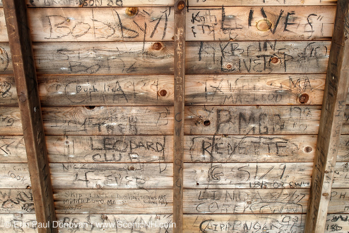 Names carved into the roof of the of Rocky Branch Shelter #2. This is an Adirondack-style shelter that sleeps 12 hikers. It is located along the Rocky Branch Trail in the Dry River Wilderness of the New Hampshire White Mountains. This shelter has been dismantled and no longer exists.