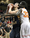 SIOUX FALLS, SD - FEBRUARY 1:  Collin Kramer #5 from Sioux Valley is fouled by Deng Geu #32 from Washington in the second quarter of their game Saturday afternoon at the Sanford Pentagon. (Photo by Dave Eggen/Inertia)
